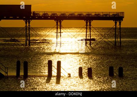 Aberystwythr pier at sunset. Aberystwyth, Ceredigion, Wales. February. - Stock Photo