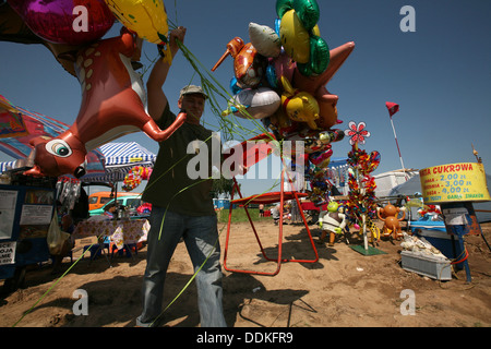 A man sells balloons during the commemoration of the 599th anniversary of the medieval Battle of Grunwald in Northern - Stock Photo