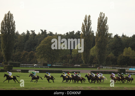 Jockeys and their horses compete during the main race at the 122nd Velka Pardubicka Steeplechase in Pardubice, Czech - Stock Photo