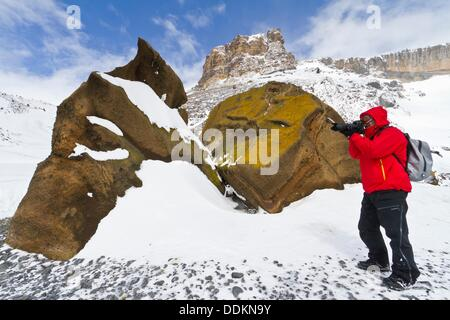 Guests from the Lindblad Expedition ship National Geographic Explorer enjoy photography in Antarctica - Stock Photo