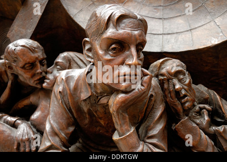 London, England, UK. St Pancras Railway Station. Detail from plinth at base of 9m high sculpture 'The Meeting Place' - Stock Photo