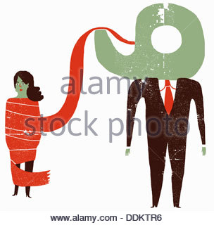 Woman tied up in red tape and businessman with tape dispenser head - Stock Photo