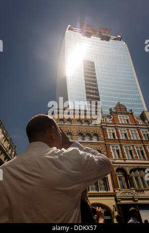 London, UK. 4th September 2013.  Londoners experience the unexpected intensity of solar rays, reflected off concave - Stock Photo