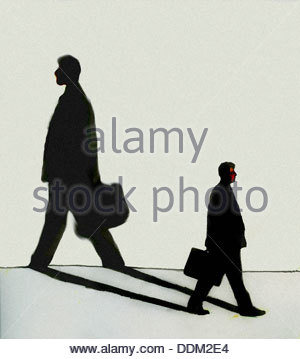 Businessman walking in opposite direction of own shadow - Stock Photo