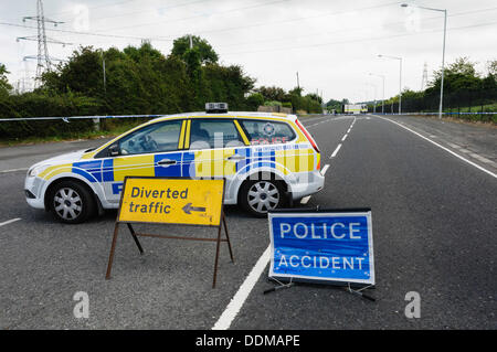Police close a road following a serious accident - Stock Photo