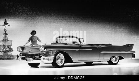 Model with a Cadillac car, 1958. - Stock Photo