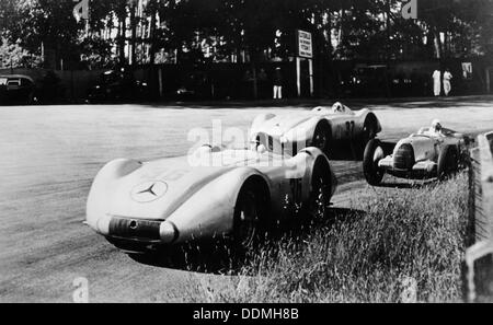 Mercedes Streamliner cars competing in the Avusrennen, Berlin, 1937. Artist: Unknown - Stock Photo