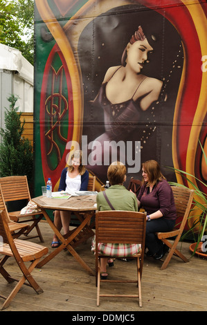 Visitors outside the Spiegeltent at the Edinburgh International Book Festival. - Stock Photo