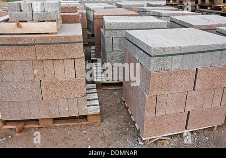 skids of breeze blocks at a builders supplies yard also known as cinder blocks in the us or Concrete masonry units