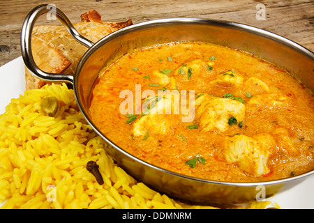 Chicken korma indian curry dish a popular takeaway choice for people who prefer mild curries - Stock Photo