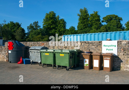 urban recycling yard with multiple types of bins - Stock Photo