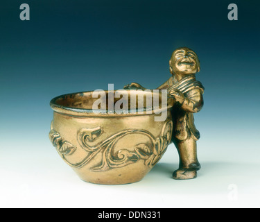 Gilt bronze water container with boy holding the rim, Ming dynasty, China, c early 16th century. Artist: Unknown - Stock Photo