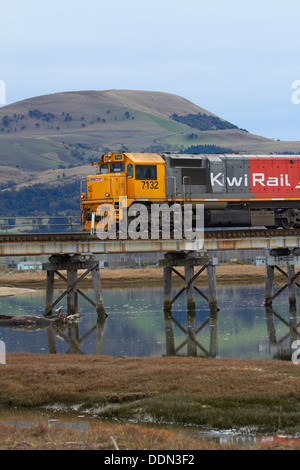 Freight train, reflected in Waikouaiti River, Karitane, Dunedin, Otago, South Island, New Zealand - Stock Photo