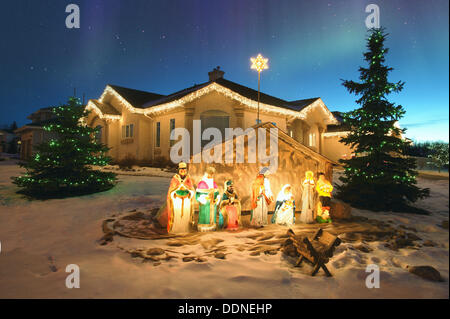 outdoor christmas nativity scene with northern lights overhead alberta canada stock photo