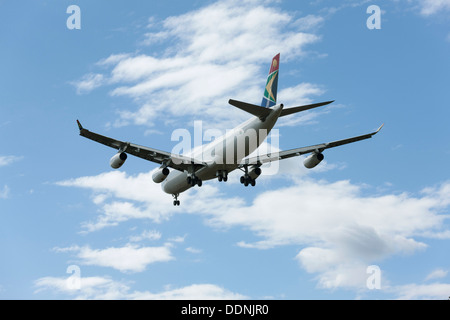 South African Airways Airbus A340-300 on final approach - Stock Photo