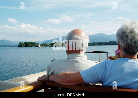 People on a ferry (Weisse Flotte) on Chiemsee. At the background: island Herreninsel (on Herreninsel you´ll find - Stock Photo