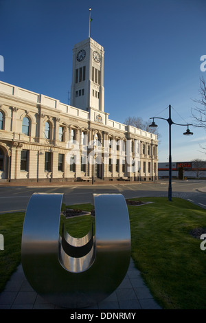 Sculpture, historic Municipal Offices and clock tower, Timaru, South Canterbury, South Island, New Zealand - Stock Photo