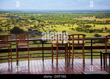 Serengeti, Tanzania, Africa. Chairs on the terrace of a lodge overlooking the plains - Stock Photo