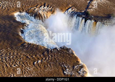 Brazil, Paraná: Aerial view of the Iguassu Falls after heavy rain falls - Stock Photo
