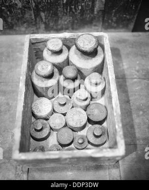 Old weights in box. Germany. - Stock Photo