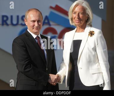 St. Petersburg, Russia. 05th Sep, 2013. Russian President Vladimir Putin (L) welcomes Managing Director of the International - Stock Photo