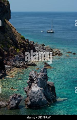 A rocky bay near Malfa on the island of Salina, The Aeolian Islands, Messina, Sicily, Italy - Stock Photo