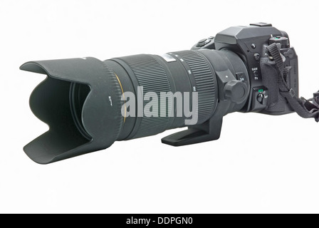 Modern DSLR camera with zoom lens attached on white - Stock Photo