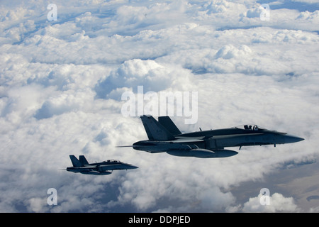 Royal Canadian Air Force CF-18 Hornets fly a mission in support of Exercise Vigilant Eagle (VE) 13, Aug. 28, 2013. - Stock Photo