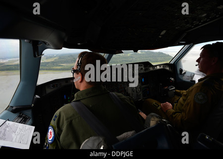 U.S. Air Force Capt. Joe Caruso and Royal Canadian Air Force Capt. Marc Andre Asselin pilot a CC-150T Polaris in - Stock Photo