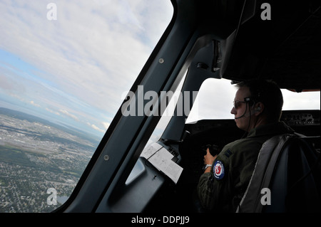 U.S. Air Force Capt. Joe Caruso an exchange pilot with the Royal Canadian Air Force pilots a CC-150T Polaris on - Stock Photo