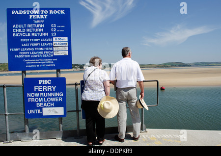Couple waiting for passenger ferry at Padstow Cornwall UK The ferry operates to Rock - Stock Photo