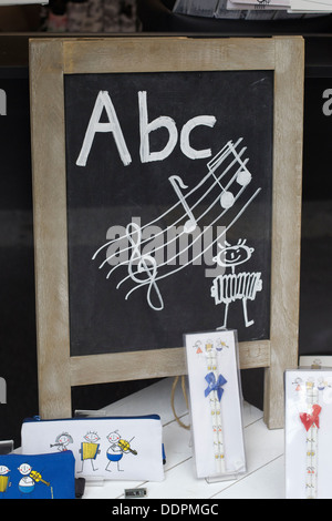 Blackboard with ABC in Musical Notes written on it - Stock Photo