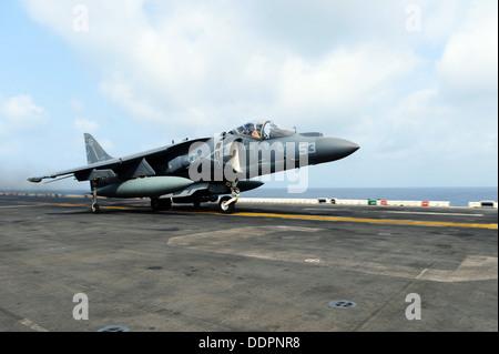 AV-8B Harrier from Marine Medium Tiltrotor Squadron (VMM) 266 (Rein) takes off from the flight deck of the amphibious - Stock Photo