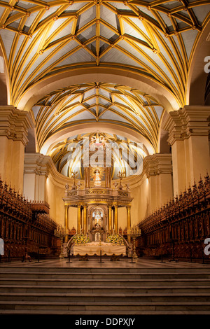 Catedral of Lima: gilded altar seen from front, with graceful gilded ribbed arched ceiling, wooden rococo choir - Stock Photo