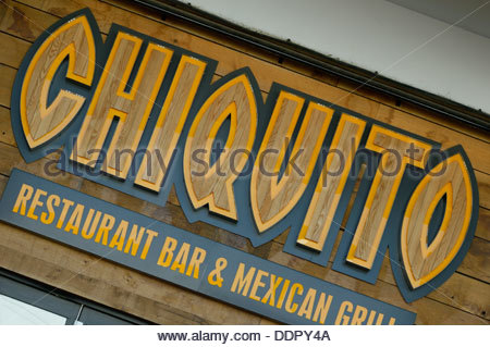 Sign above the entrance to Chiquito Restaurant Bar and Mexican Grill, Tower Park, Yarrow Road, Poole, Dorset, England - Stock Photo