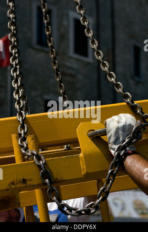 support chains on crane boom - Stock Photo