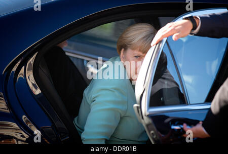 St. Petersburg, Russia. 06th Sep, 2013. German Chancellor Angela Merkel gets out of her limousine at the G20 summit. - Stock Photo