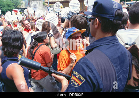 Police in demonstration by animal rights activist during San Fermin festival. Pamplona. Navarra, Spain - Stock Photo