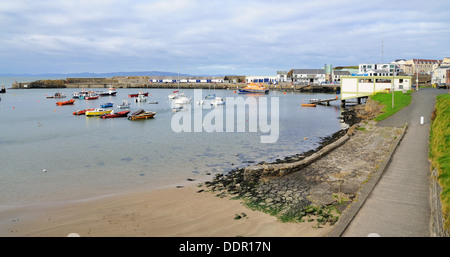 Small harbor with boats in the Portrush city, Northern Ireland. - Stock Photo
