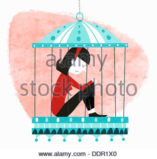 Unhappy woman sitting in birdcage - Stock Photo