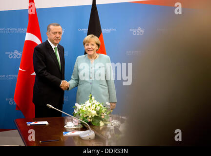 St. Petersburg, Russia. 06th Sep, 2013. German Chancellor Angela Merkel is welcomed by Recep Tayyip Erdogan, Prime - Stock Photo