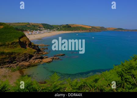 Pentewan beach and coast Cornwall between Mevagissey and Porthpean England UK green sea blue sky and deep rich colours - Stock Photo