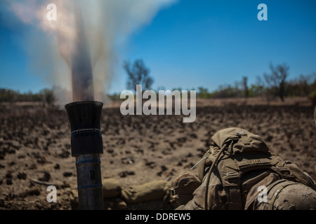 A Marine with Battalion Landing Team 2nd Battalion, 4th Marines, 31st Marines Expeditionary Unit, takes cover as - Stock Photo