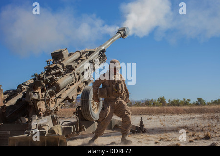 A Marine with Weapons Co., Battalion Landing Team 2nd Battalion, 4th Marines, 31st Marines Expeditionary Unit, fires - Stock Photo