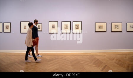 Two employees walk through an exhibition of works impressionist Camille Pissaro at the Art Museum Pablo Picasso - Stock Photo