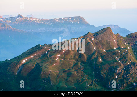 First light on the Lauberhorn from the Rotstock above Grindelwald Switzerland with the Lobhörner beyond - Stock Photo
