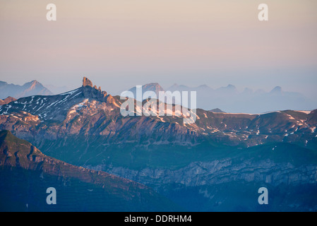 First light on the Lobhörner from the Rotstock above Grindelwald Switzerland - Stock Photo