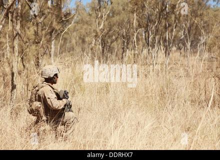 A Marine with Lima Company, 3rd Battalion, 3rd Marine Regiment, Marine Rotational Force - Darwin, waits to begin - Stock Photo