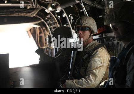 Marines with Lima Company, 3rd Battalion, 3rd Marine Regiment, Marine Rotational Force - Darwin, ride in an MV-22B - Stock Photo