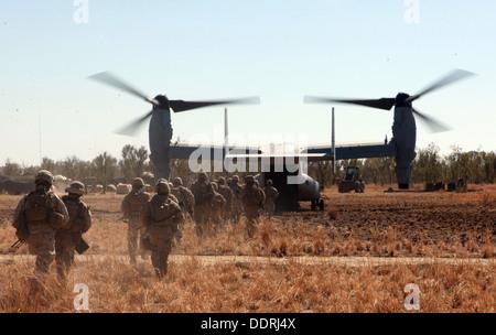 Marines with Lima Company, 3rd Battalion, 3rd Marine Regiment, Marine Rotational Force - Darwin, load into an MV - Stock Photo